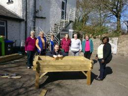 Staff and service users at work on the Abbeyview Day Centre garden