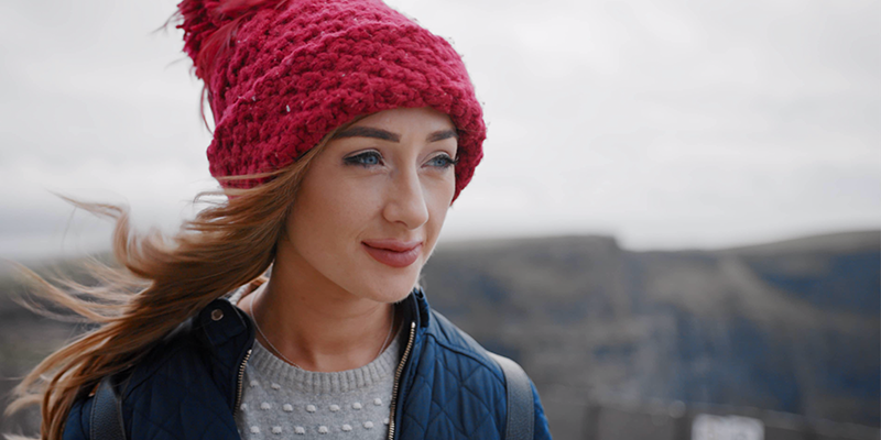 Laura Brennan in red hat