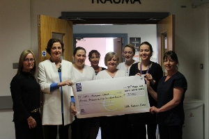 UHL fashion show cheque presentation