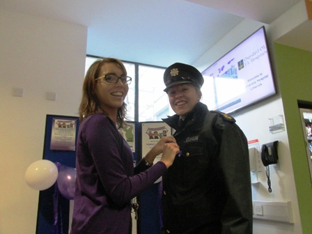 Sarah O'Rourke, medical social worker, University Hospital Limerick, pins a purple ribbon on Garda Niamh Briggs as the 16 Days of Action Campaign got underway at UHL this Wednesday